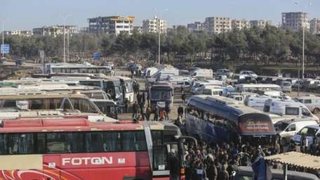 Syrians evacuated from the embattled Syrian city of