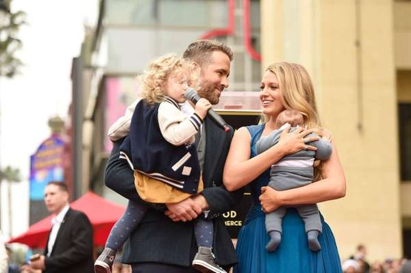 Ryan Reynolds and Blake Lively pose with their