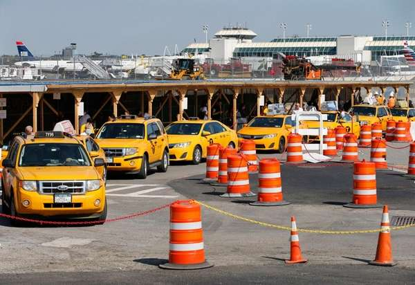 Taxis line up near Terminal B at LaGuardia