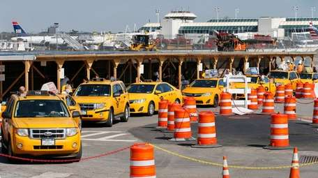 Taxis line up near Terminal B at LaGuardia