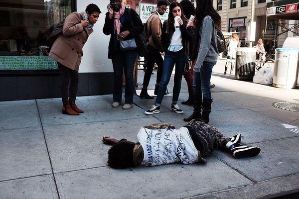 A man sleeps on a Manhattan street on