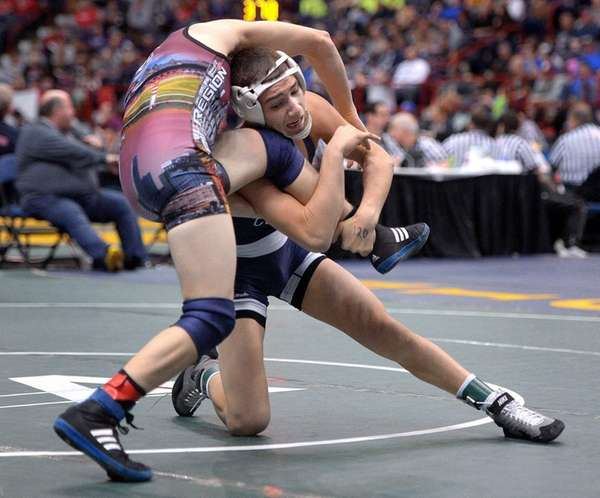 Hauppauge's Jake Silverstein, right, wrestles against Columbia's John