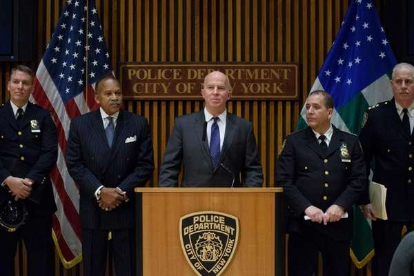 New York City Police Commissioner James O'Neill, center,