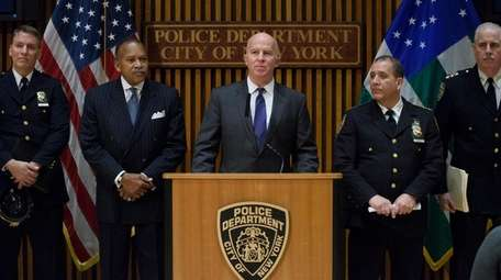 New York City Police Commissioner James O'Neill, center,