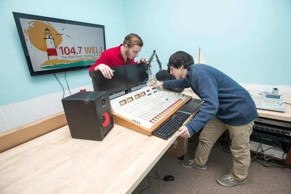 Andrew Adams, left, promotions manager of WELJ 104.7