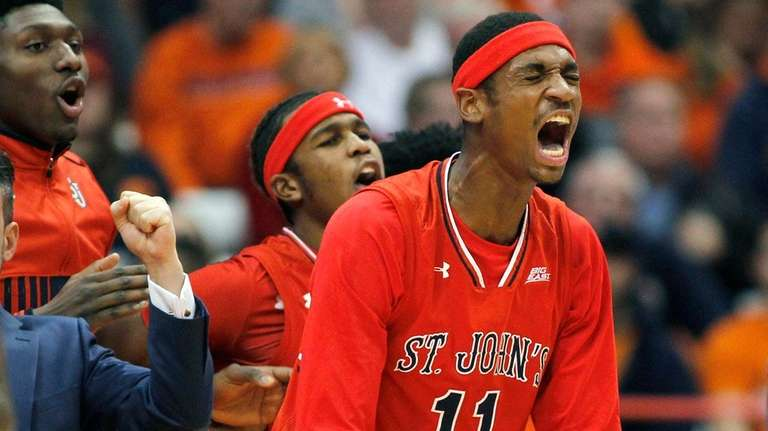 St. John's Tarig Owens, right, yells after a