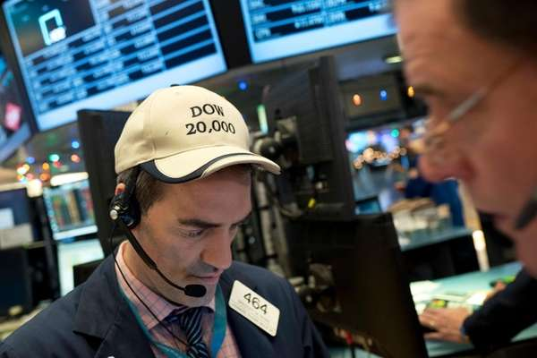 Gregory Rowe follows stock prices at the New