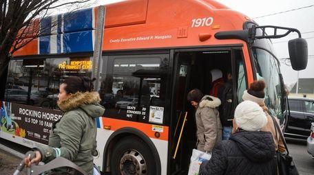 Passengers use a NICE bus on Dec. 8,