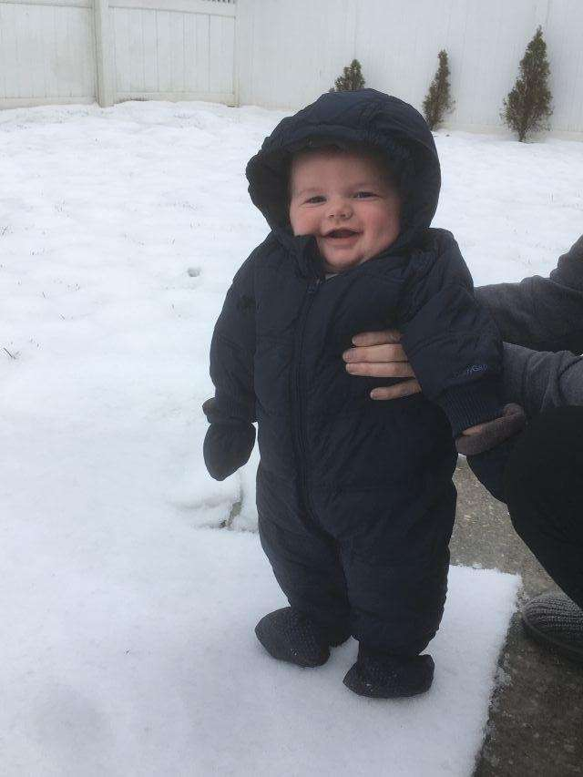 Baby Justin's first time in the snow!