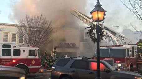 Firefighters battle a blazing storefront fire which closed