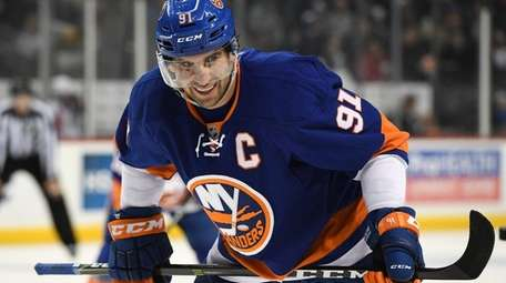 New York Islanders center John Tavares looks on