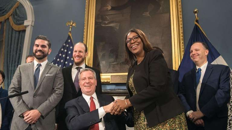 Mayor Bill de Blasio shakes hands with Tish