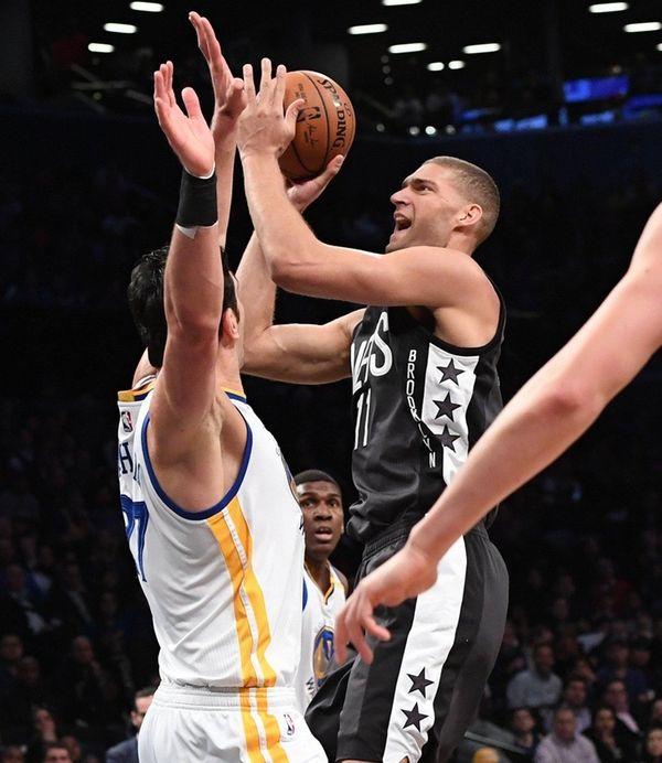Brooklyn Nets center Brook Lopez puts up a