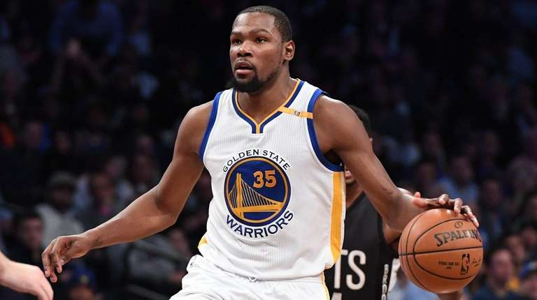 Golden State Warriors forward Kevin Durant controls the