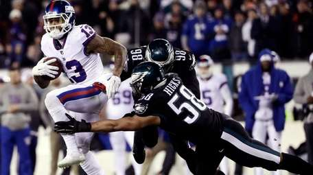 New York Giants' Odell Beckham (13) tries to