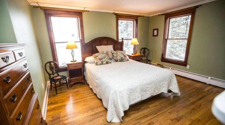 The master bedroom of this historic home in