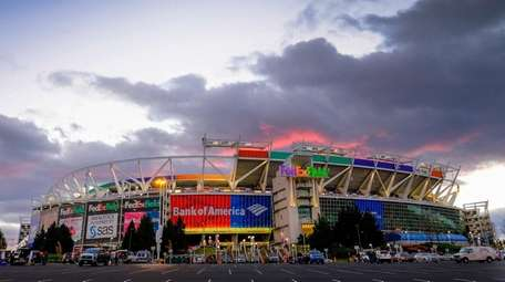 The sun sets behind FedEx Field before a