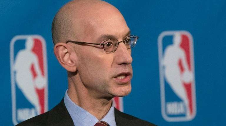 NBA Commissioner Adam Silver speaks to reporters during