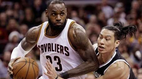 LeBron James drives against Nets' Jeremy Lin in