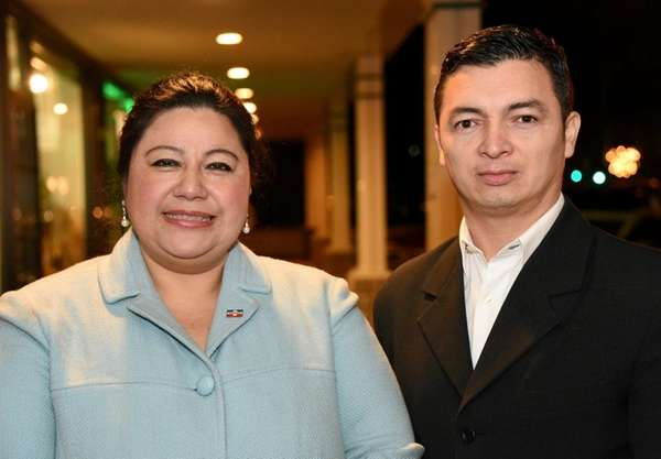 Local activists Elsa Valle and Ever Padilla outside
