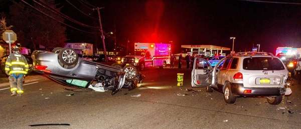 A three-vehicle collision caused one to overturn Friday,