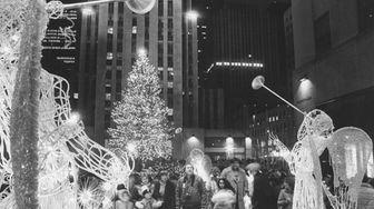 Visitors admire Rockefeller Center's trumpeting angels on Dec.