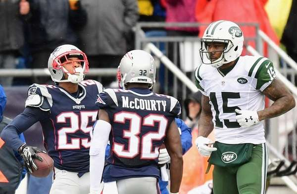 Eric Rowe reacts with Devin McCourty after intercepting