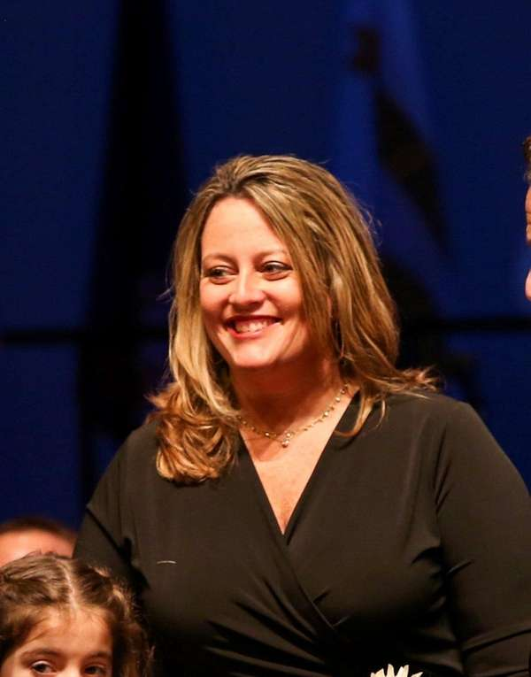 Tracey Bellone watches as her husband, Suffolk County