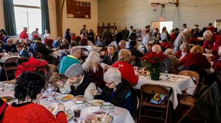 More than 150 people feasted on ham, turkey