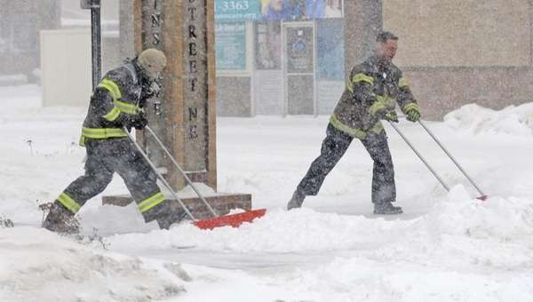 Mandan firefighters Shane Weltikol, left, and Chad Nicklos