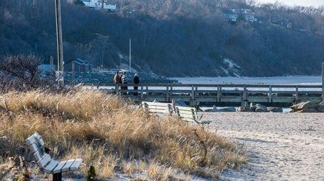 Visitors to Cedar Beach in Mount Sinai walk