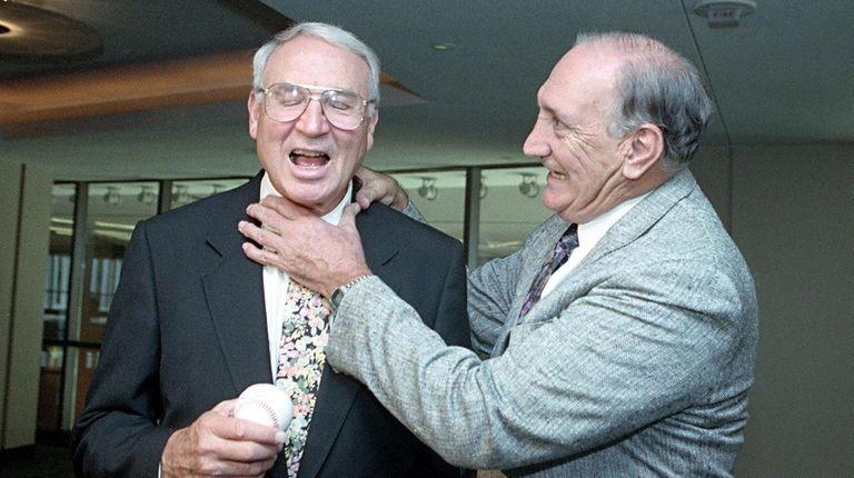 Ralph Branca, right, pretends to choke Bobby Thomson