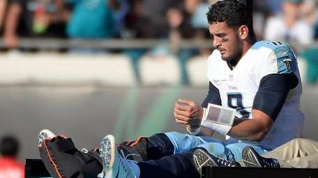 Tennessee Titans quarterback Marcus Mariota leaves the field