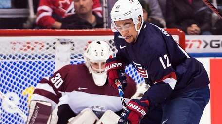 United States' Jordan Greenway (12) eyes the puck