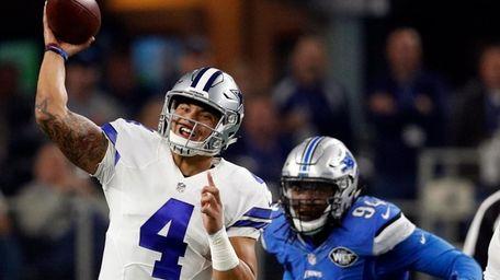 Dallas Cowboys' Dak Prescott (4) throws a pass
