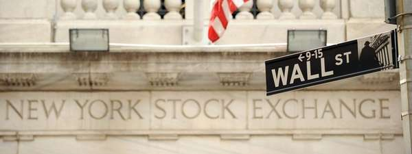 The Wall Street street sign outside an entrance