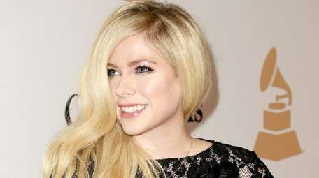 Avril Lavigne arrives at an event on Feb.
