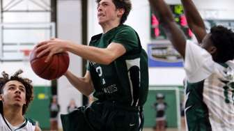 Harborfields guard Shane Wagner (2) drives to the