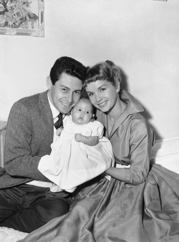 Eddie Fisher and Debbie Reynolds hold their daughter,