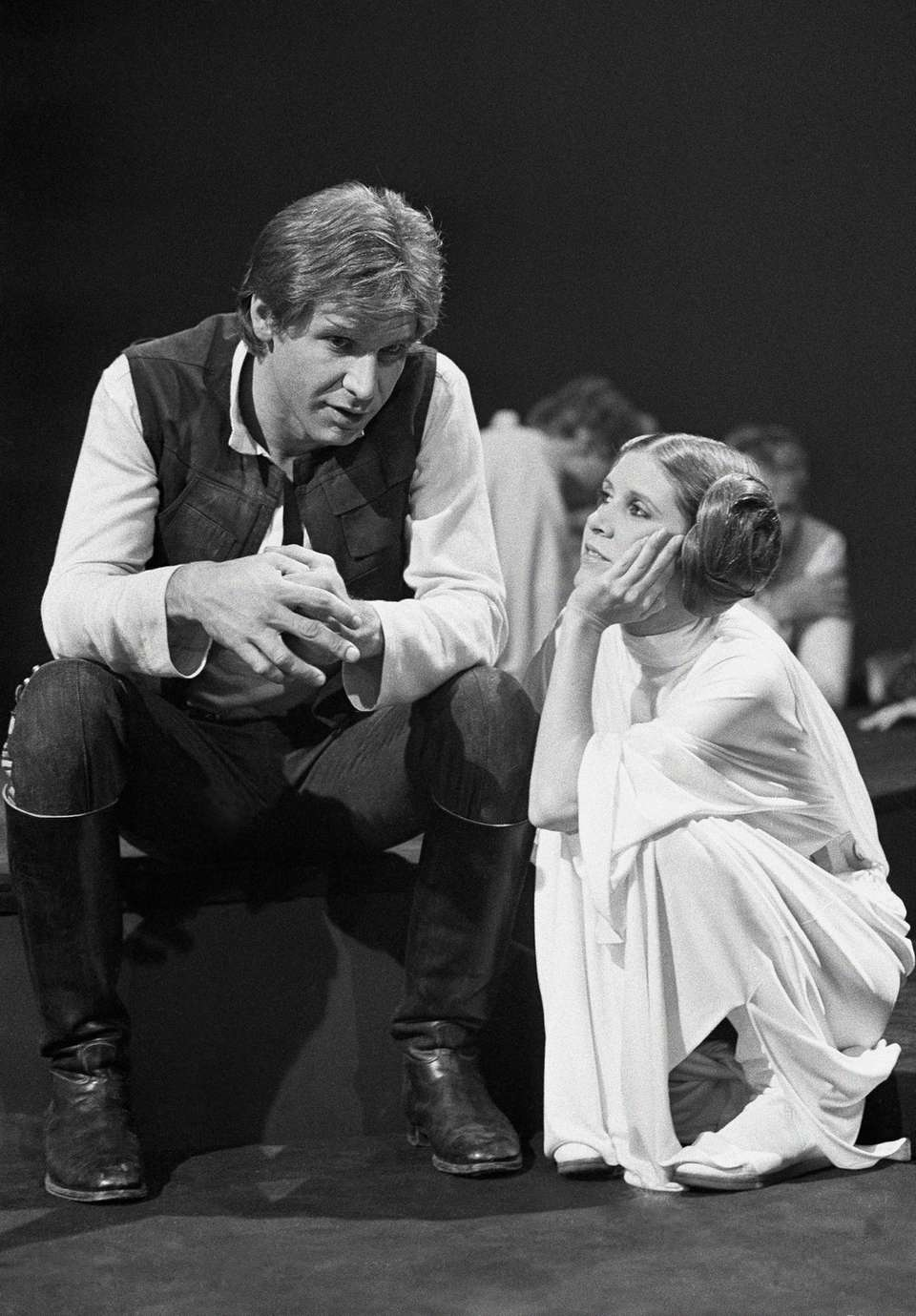 Harrison Ford talks with Carrie Fisher during a