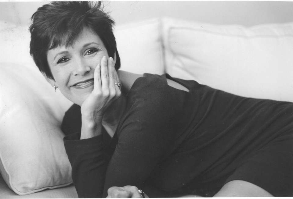 Carrie Fisher poses on Sept. 5, 1990, in