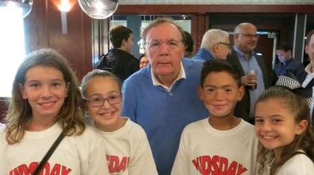 Author James Patterson with Kidsday reporters, from left,