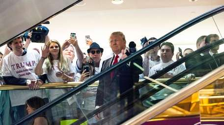 Donald Trump rode a Trump Tower escalator before