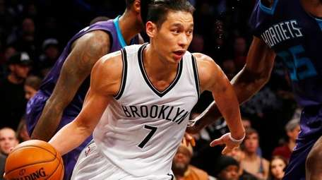 Jeremy Lin #7 of the Brooklyn Nets drives