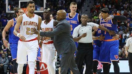 Atlanta Hawks guard Thabo Sefolosha, far left, and