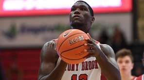 Stony Brook forward Tyrell Sturdivant shoots a free