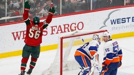 Minnesota Wild's Erik Haula, left, of Finland celebrates