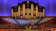 The Mormon Tabernacle Choir and church leaders sing