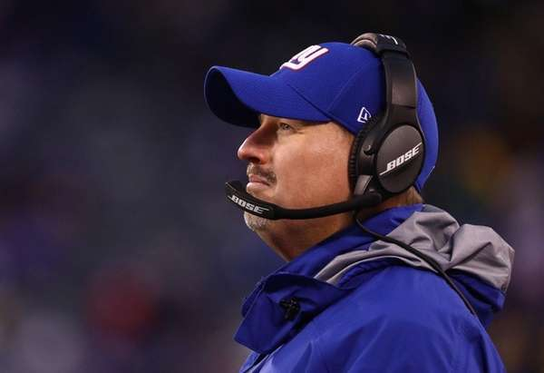 Giants  head coach Ben McAdoo looks on against