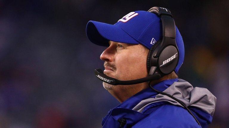 Giants head coach Ben McAdoo looks on against
